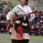 Musician performing ancient folk songs, Shey Gompa Festival